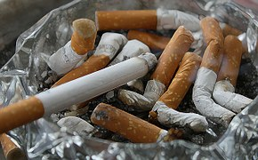 ashtray full of old cigarette butts that smell dire